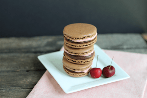 chocolate macaron recipe: chocolate macarons filled with cherry frosting and chocolate ganache