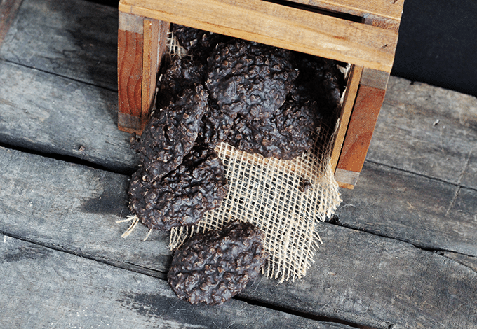 batch of chocolate no bake cookies in a wooden crate