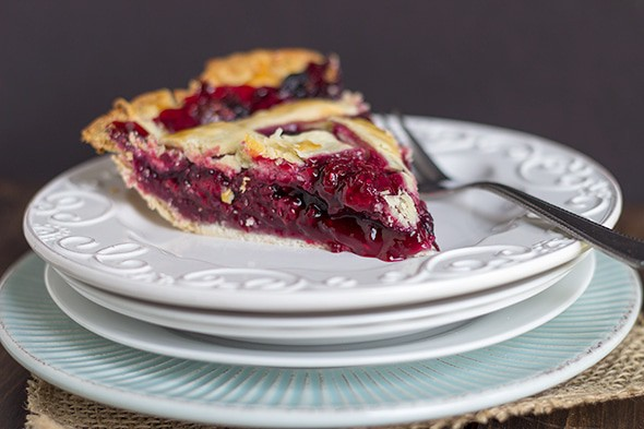 slice of fresh blueberry-blackberry pie on a plate