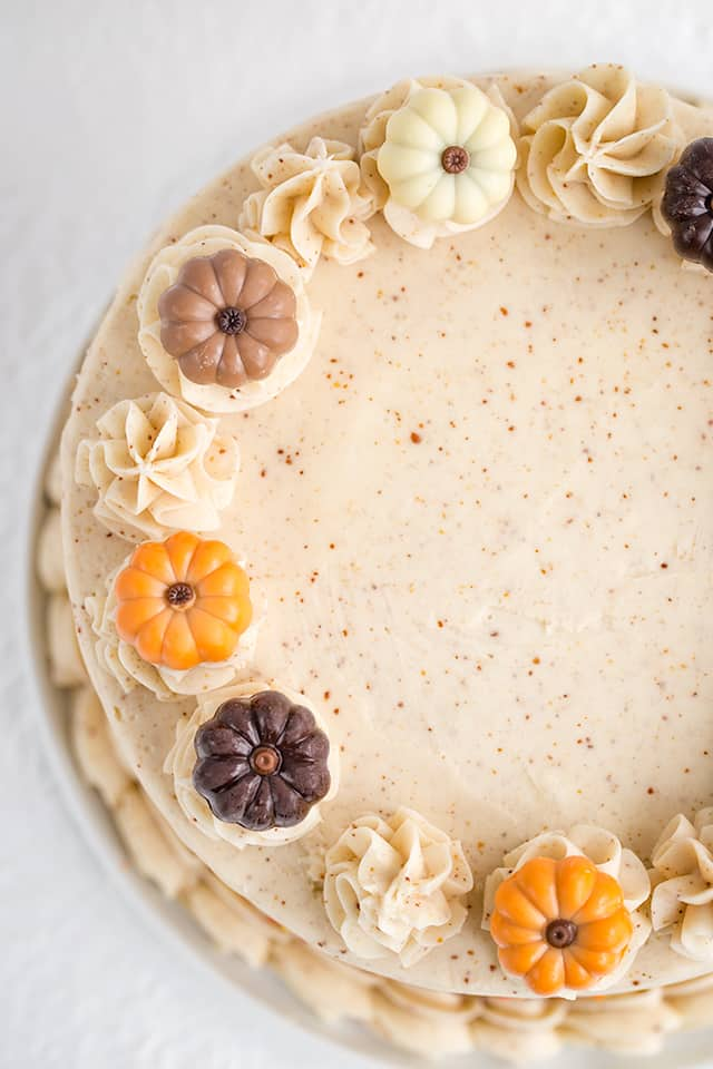 overhead photo of pumpkin spice cake showing the colorful pumpkin truffles