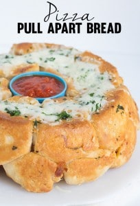 Pizza Pull Apart Bread - Fun pull apart bread with a delicious pizza filling and a garlicky exterior. This is a fun dinner if you have a little picky eater.