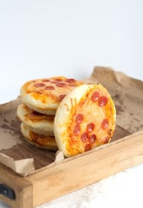 Mini Pizzas stacked onto a serving tray