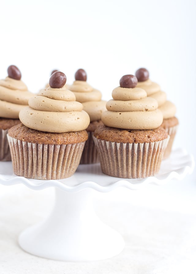 Coffee Cupcakes with Coffee Buttercream on a white cake stand