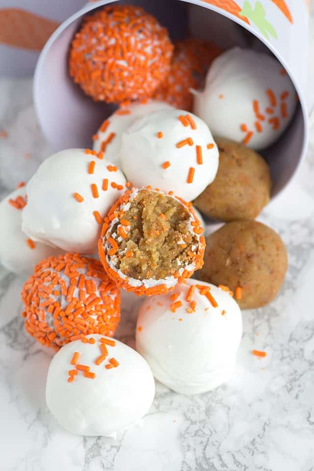 carrot cake cake pops decorated with white chocolate coating and orange sprinkles