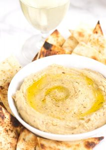Grilled Tortilla Chips and Hummus - make your own chips and season them too! These are the perfect grilling chips for a cookout. They're done in minutes! Don't forget the homemade hummus!