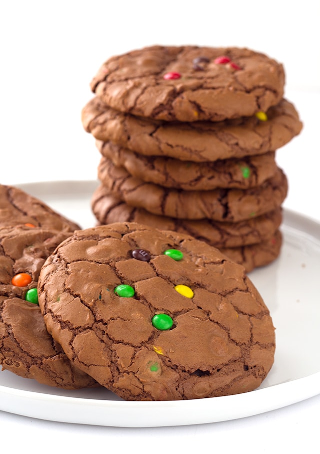 stacked Brownie Cookies with M&M's on a white plate