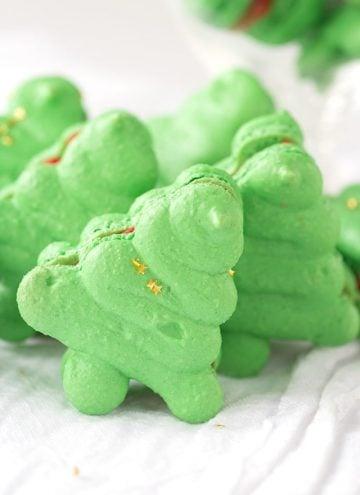 Christmas Macarons shaped like Christmas trees on a white linen
