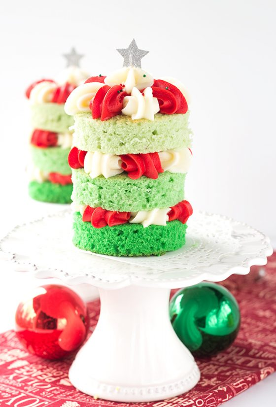 Christmas Tree Cake - Fun and festive green ombre cakes with red and white frosting piped in pretty shells.