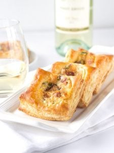 Jalapeno Popper Bites - a delicious appetizer with golden puff pastry loaded with jalapenos, pepper jack and cheddar cheese, and loads of bacon.