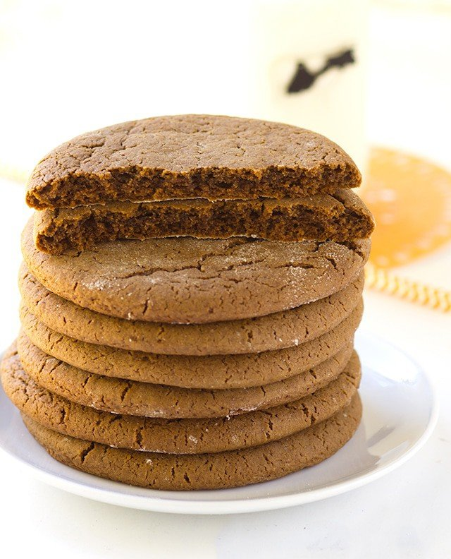 stack of Molasses Cookies with one broken in half so you can see the chewy center