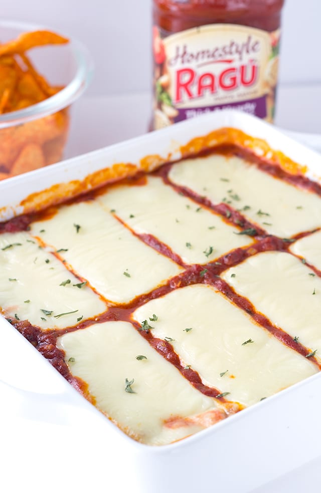 warm dip with ricotta, mozzarella, and parmesan cheeses as well as hot sausage and Ragu sauce