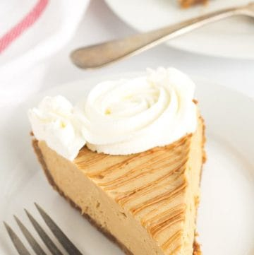 Cookie Butter Pie -a speculoos cookie crust with a creamy cookie butter cheesecake mousse filling. Drizzle with a little additional cookie butter and pipe some whipped cream swirls to finish the pie.