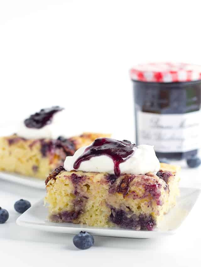 Bacon Blueberry Baked Pancakes - Need to feed a crowd or maybe just want to make a big brunch?This baked pancake done in a casserole dish is the way to go. It's packed with candied bacon, blueberry preserves, and brie cheese. Top with whipped cream and some more preserves and eat up!