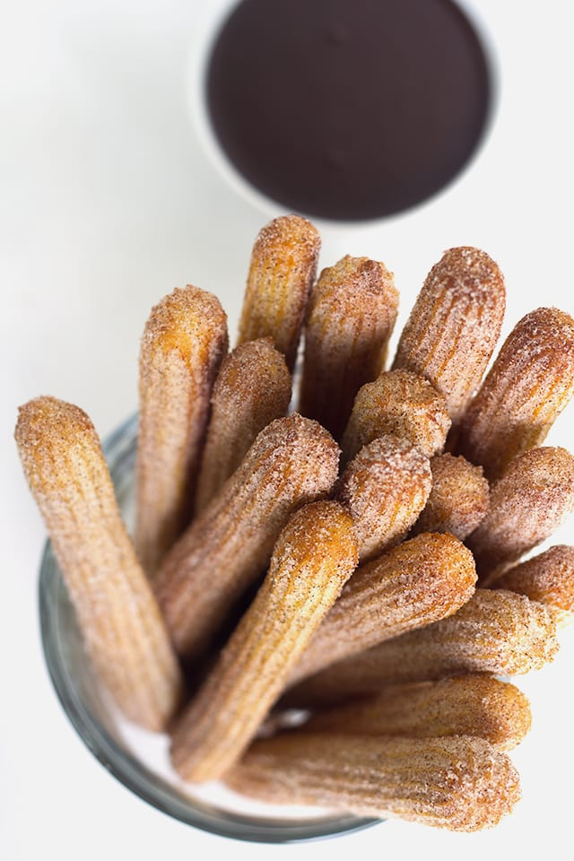 Baked Churros - These baked churros are just as good as any fried churro! It has a crunchy exterior that's been rolled in cinnamon and sugar and a tender inside. They're highly addicting and fun to dip!