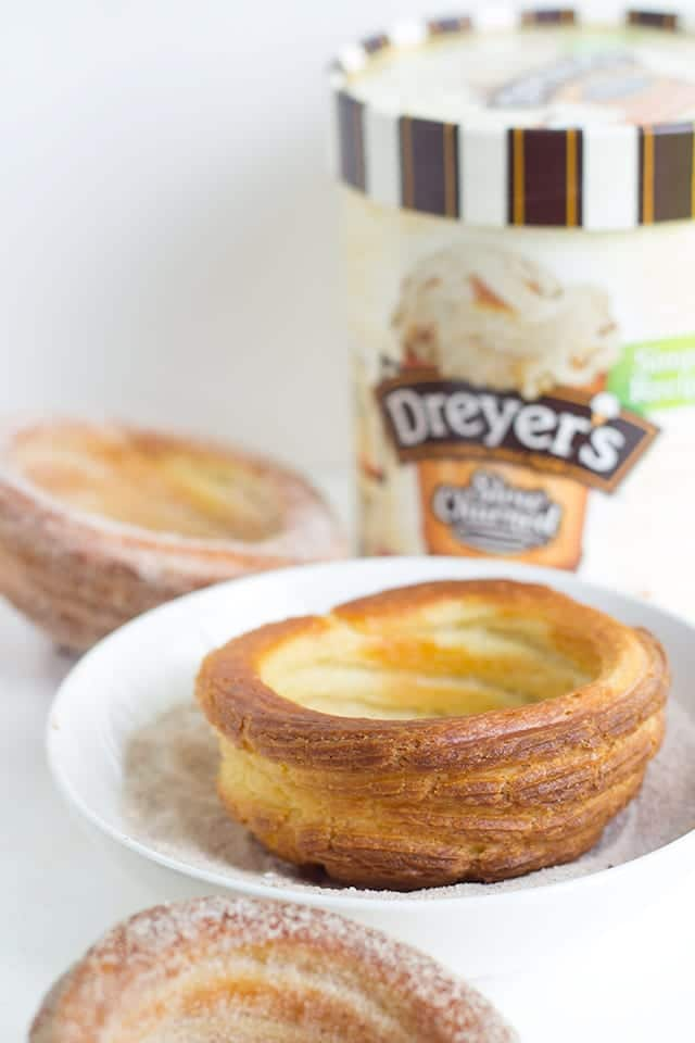 Churro Ice Cream Cups that are easy to make and fun to eat! They're piped on cupcake tins for the perfect serving size and baked, not fried, so they're a little better for you. They're perfect for summer parties and everyone eats their cup so no dirty dishes.