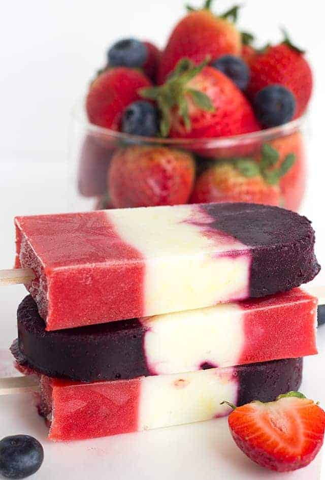 Red White and Blue Berry Yogurt Pops - Yogurt Pops for the 4th of July. They're full of fresh berries and lemon yogurt!