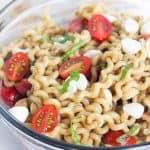 clear glass bowl full of Caprese Pasta Salad