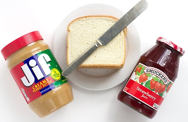 Toasted Peanut Butter and Jelly Sandwich - peanut butter, jam, butter, and two slices of toasted bread thrown together to make the perfect lunch sandwich.