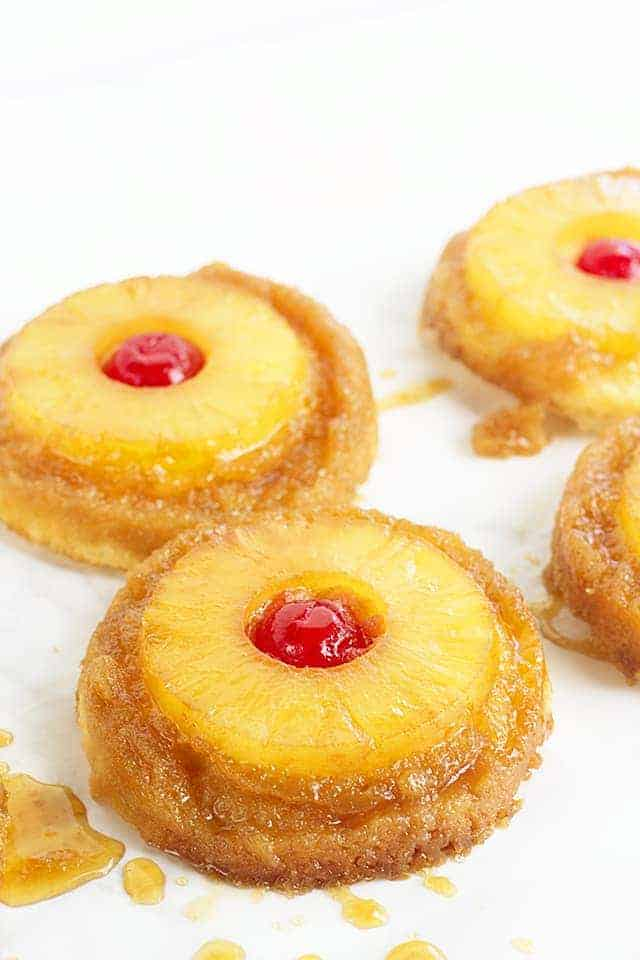 Pineapple Upside Down Cookies - Pineapple upside down cake in cookie form because everyone loves cookies! Soft sugar cookie bottoms with a ring of pineapple and cherry center all covered in a brown sugar glaze!