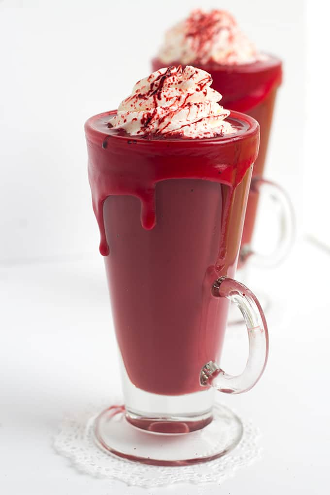Bloody Red Velvet Hot Chocolate - The perfect halloween drink! This thick and creamy red velvet hot chocolate is made with cake mix and chocolate chips! It tastes like a slice of red velvet cake too!