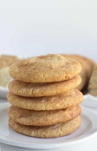 Pumpkin Cheesecake Snickerdoodles - These cookies are the perfect shortcut cookies for a holiday cookie tray.. They are stuffed with a creamy pumpkin cheesecake filling that adds an additional bit of flavor! The outside is slightly crunchy from the cinnamon sugar coating.