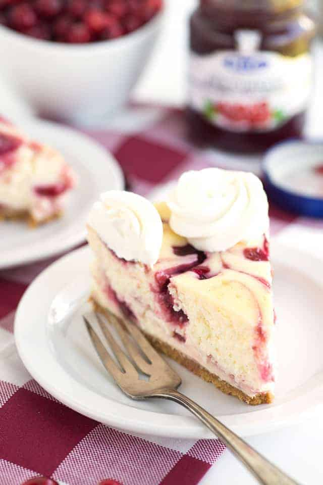 Cranberry Red Currant Cheesecake - Creamy vanilla cheesecake with swirls of cranberry and red currant throughout it. This cheesecake is perfect for the holidays!