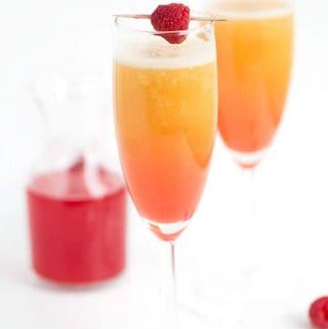 peach raspberry bellini with a raspberry syrup