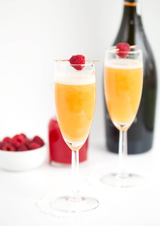 Peach Raspberry Bellini - raspberry infused simple syrup, peach puree, and sparkling wine come together to make a great fruity bellini! This is a drink for any and all occasions!