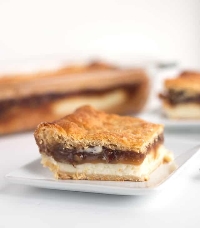 A slice of pecan pie cheesecake bars