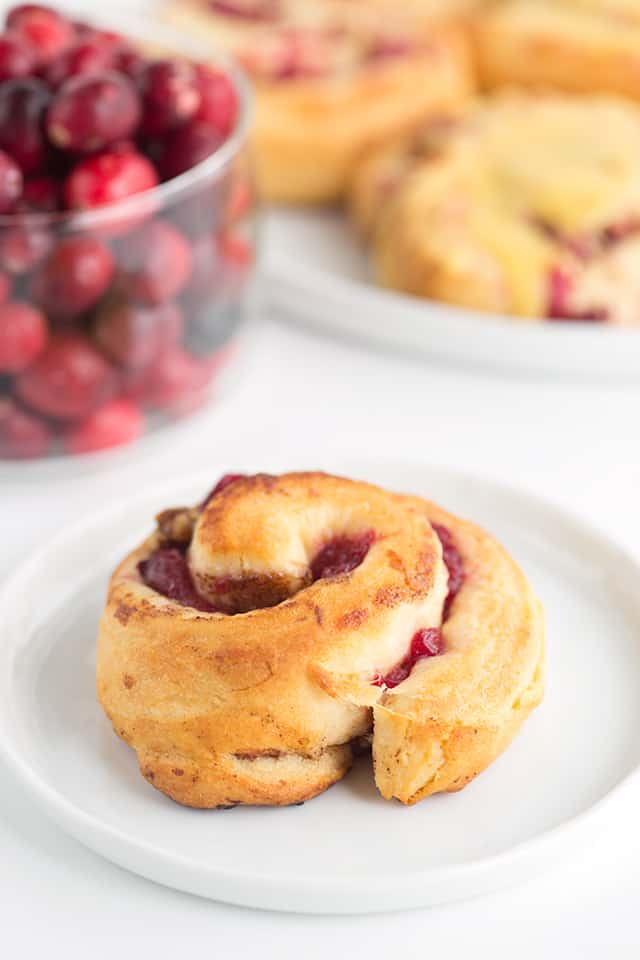 One cranberry orange cinnamon roll on a plate