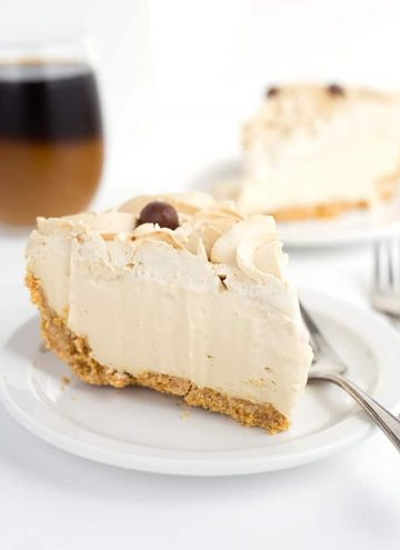 slice of frozen coffee cream pie on a white plate with another slice in the background