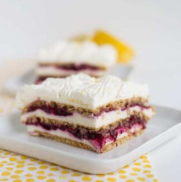 Blueberry lemon icebox cake on a white plate with yellow polka dotted linen
