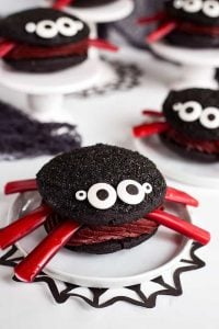 Spider Whoopie Pies on a white plate with black spider web