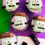 Frankenstein Cupcakes with black licorice and purple background