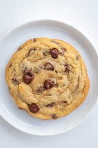 Close up chocolate chip cookie on a white plate