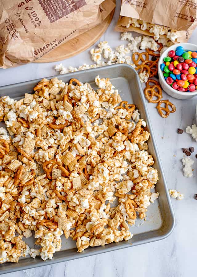 sheet pan with caramel chex mix in it