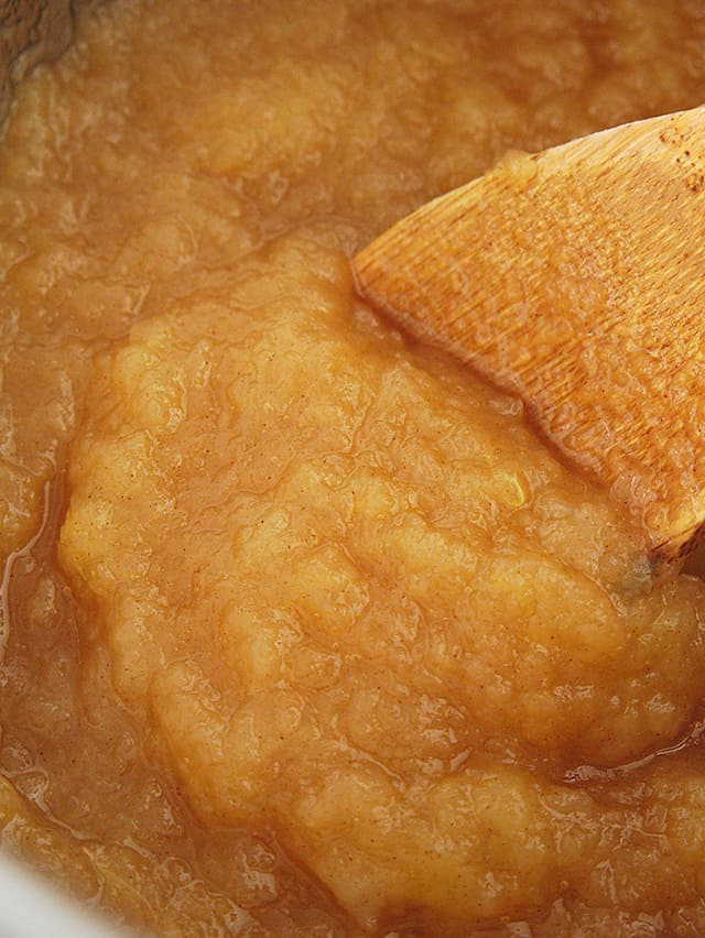 close up of prepared instant pot applesauce with wooden spoon