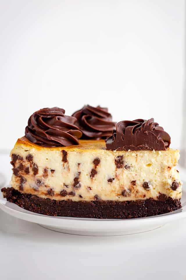 side of a slice of brownie chocolate chip cheesecake
