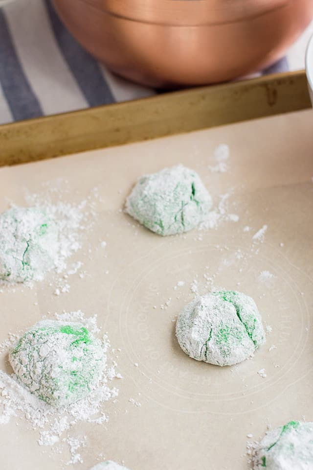 Cake Mix Crinkle Cookie dough on a parchment paper lined baking sheet