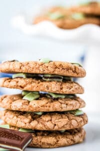 Andes mint cookies stacked on a plate with Andes mints