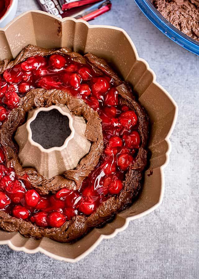 chocolate cherry bundt cake being made in bundt pan
