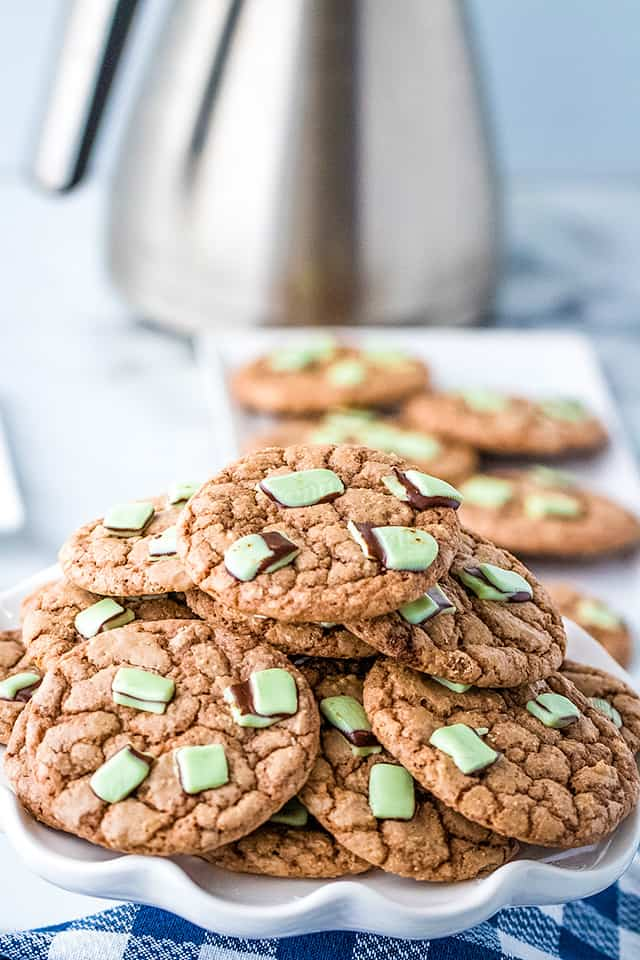 pile of chocolate mint cookies on a scalloped plate