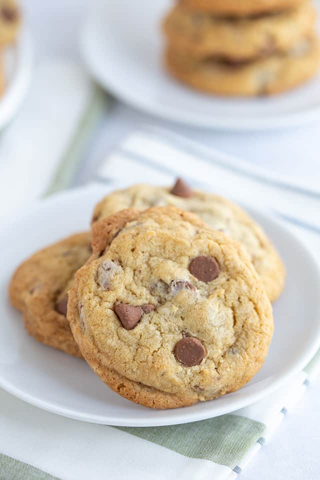 chocolate chip cookie propped up on white plate