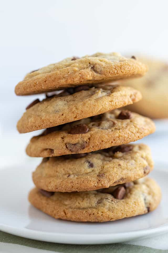 chocolate chip cookies stacked on a dessert plate