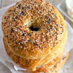 stack of homemade everything bagels with a close up on the everything bagel seasoning