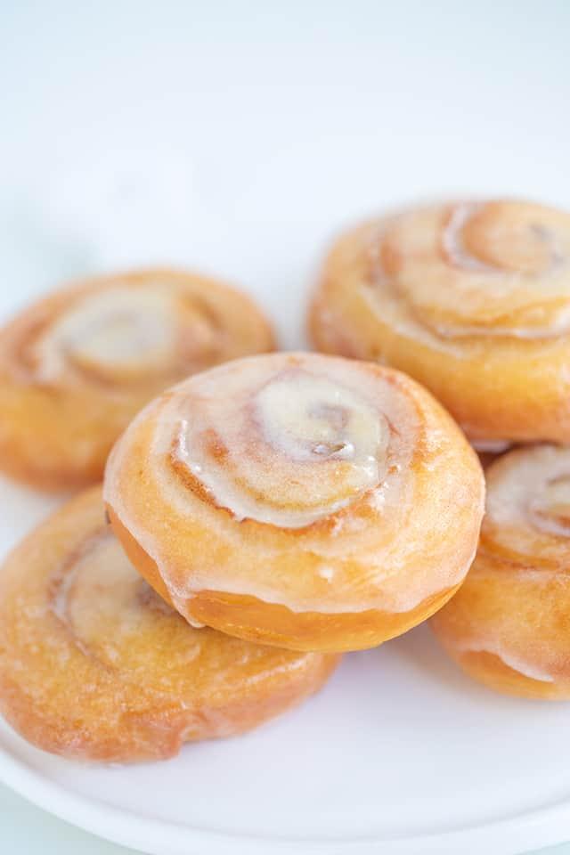close up of homemade honey buns on white platter