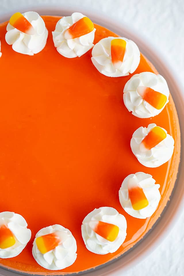 overhead of cheesecake showing half of the cheesecake on a white background