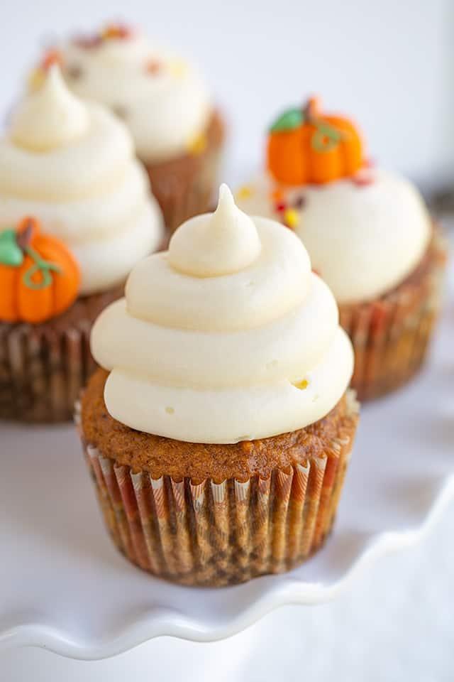 closeup of cupcake on a white wavy cake plate