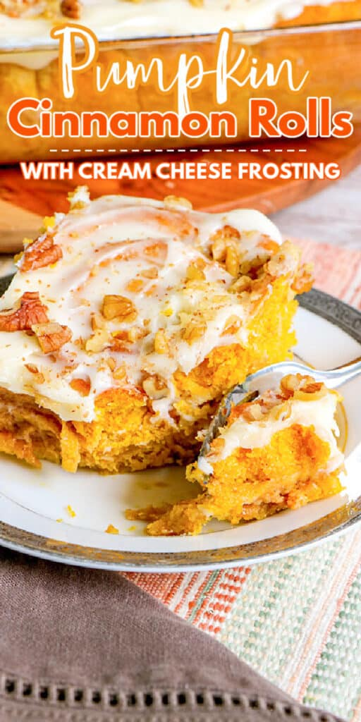 closeup of pumpkin cinnamon rolls on a plate with a fork