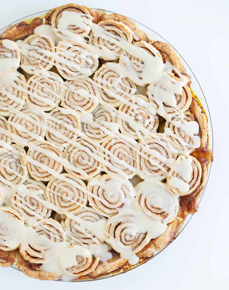 overhead photo of apple pie with a cream cheese glaze drizzled on top